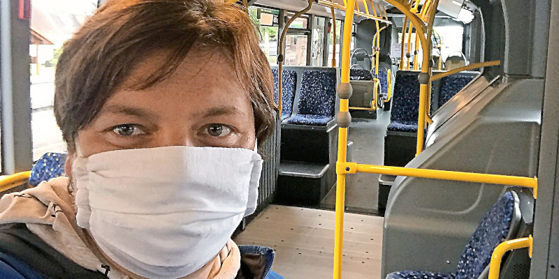 Passenger wearing mask in Tórhavn city bus (Image credits: Tórshavn Municipality)